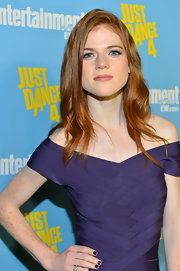 Rose Leslie's side part broke up her long hairstyle and made it look more voluminous.
