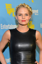 Jennifer countered her tough leather dress with a youthful braided updo.