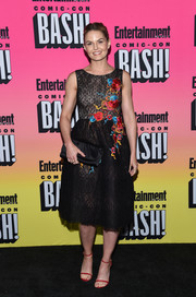 A black satin clutch tied Jennifer Morrison's look together.