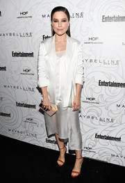 Sophia Bush played down the sexiness with a white blazer.