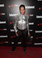 Regina King chose a pair of black silk slacks to team with her funky top.