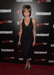 Lisa Rinna styled her dress with a pair of black and gold ankle-strap sandals.