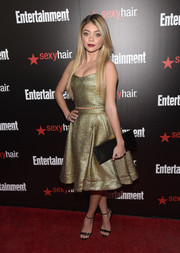 Rounding out Sarah Hyland's black accessories was a Salvatore Ferragamo satin clutch.