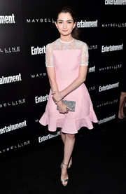 Emily Robinson was sweet and demure in a pink cocktail dress with a sheer yoke and a ruffle hem during the Entertainment Weekly celebration honoring the SAG nominees.