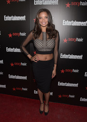 Rochelle Aytes opted for a basic black pencil skirt to team with her crop-top.