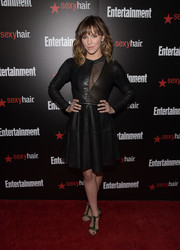 Katharine McPhee teamed her fierce dress with black and gold T-strap sandals by Daniele Michetti.