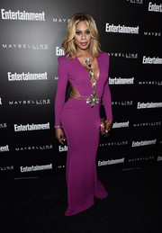Laverne Cox looked seriously sexy in a plunging fuchsia cutout gown by Michael Costello at the Entertainment Weekly celebration honoring the SAG nominees.