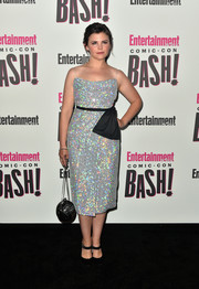 A spherical bag with a silver chain strap finished off Ginnifer Goodwin's look.