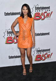 Candice Patton was cool and edgy in an orange leather vest dress by Concepto at the Entertainment Weekly Comic-Con party.