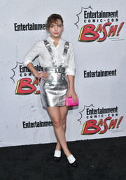 Camren Bicondova added a bright pop with a hot-pink satin clutch.