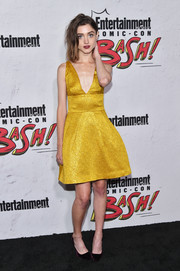 Natalia Dyer paired her frock with purple velvet pumps.