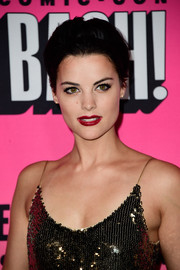 Jaimie Alexander added a pop of color with a swipe of red lipstick.