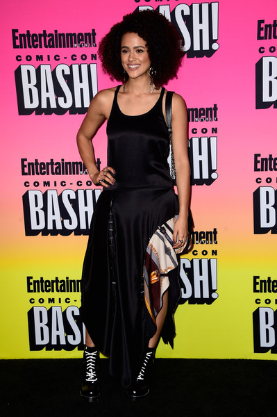 Nathalie Emmanuel went edgy-chic in a black asymmetrical-hem maxi dress by Louis Vuitton at the Entertainment Weekly Comic-Con party.