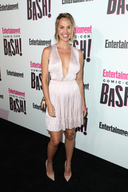 Arielle Kebbel took a daring plunge with this deep-V pink dress at the Entertainment Weekly Comic-Con celebration.