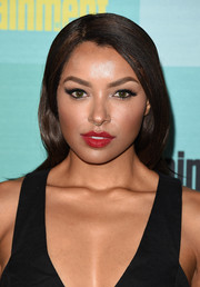Kat Graham looked elegant wearing this slicked-down side-parted 'do at the Entertainment Weekly Comic-Con party.