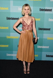 Bella Heathcote added a dose of edge with a pleated tan leather skirt, also by Gucci.