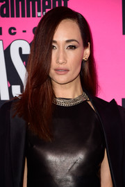 Maggie Q paired her edgy outfit with a chain collar necklace.