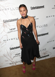 Jamie Chung gave her look a dazzling pop of color with a pair of pink broad-strap pumps by Nicholas Kirkwood.
