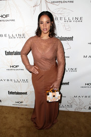 Dascha Polanco attended Entertainment Weekly's SAG Awards nominees celebration wearing a dual-textured tan maxi dress.