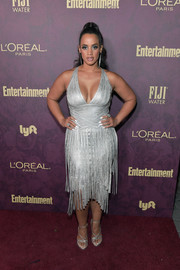 Dascha Polanco matched her dress with a pair of strappy silver sandals.