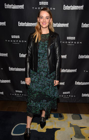 Jess Weixler gave her dress a dose of edge with a black leather jacket.
