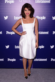 Priyanka Chopra paired her pretty dress with monochrome striped pumps by Christian Louboutin.