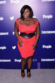 Danielle Brooks went for edgy styling with a pair of black ankle-cuff sandals and a wide leather belt.