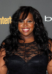 Amber Riley paired a long curly 'do with a lace dress for a sweet finish at the Entertainment Weekly pre-Emmy party.