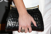 Meredith Monroe accessorized with a very stylish black crocodile clutch when she attended the Entertainment Weekly pre-Emmy party.