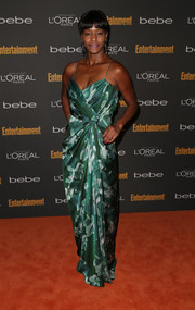 Sufe Bradshaw attended the Entertainment Weekly pre-Emmy party wearing a draped print dress.