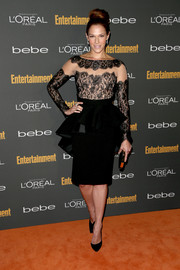 Amanda Righetti looked perfectly elegant in a peplum dress with a lace bodice during the Entertainment Weekly pre-Emmy party.