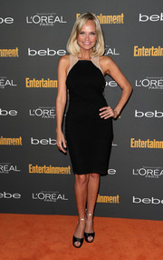 Kristin Chenoweth continued the nude-black theme with her satin evening sandals.