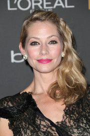 Meredith Monroe sweetened up her look with a side-swept curly 'do when she attended the Entertainment Weekly pre-Emmy party.