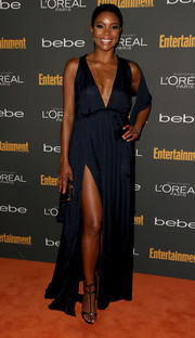 Gabrielle Union oozed sultriness at the Entertainment Weekly pre-Emmy party in a navy evening dress with a plunging neckline and a thigh-baring slit.