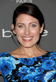 Lisa Edelstein sported a classic side-parted updo at the Entertainment Weekly pre-Emmy party.