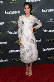Jamie Chung looked distinct in a white Marchesa lace dress with a printed underlay during the Entertainment Weekly pre-Emmy party.