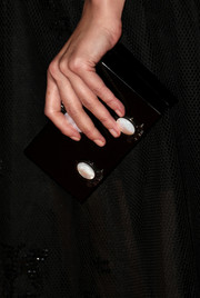 Jessica Pare attended the Entertainment Weekly pre-Emmy party carrying an embellished black box clutch.