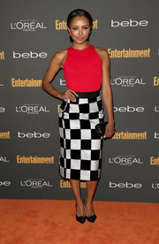 Kat Graham looked smart and fun in a black-and-white checkered skirt and a red tank top at the Entertainment Weekly pre-Emmy party.