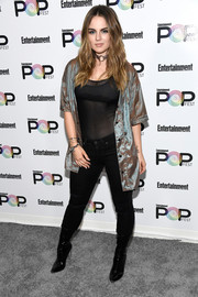 Jojo layered an unbuttoned satin shirt over a sheer top for her Entertainment Weekly PopFest look.