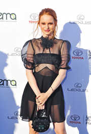 Madelaine Petsch arrived for the 2017 EMA Awards carrying a studded leather purse.