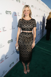 Amy Smart paired her sultry dress with nude ankle-strap sandals.