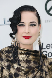 Dita Von Teese finished off her beauty look with her usual perfect red lip.