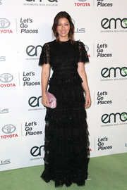 Jessica Biel amped up the girly vibe with a pleated pink satin clutch by Fendi.