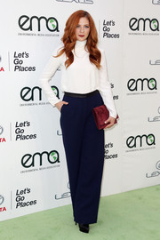 Rachelle Lefevre's burgundy suede clutch provided a chic contrast to her blue pants.