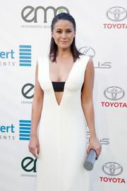 Emmanuelle Chriqui teamed a silver tube clutch with a sexy cutout dress for the EMA Awards.