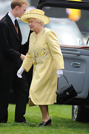 Queen Elizabeth was a ray of sunshine in a yellow embroidered coat for the royal wedding.