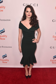 Vanessa Marano showed off her slender figure in a dark green off-the-shoulder dress at the Make Equality Reality Gala.