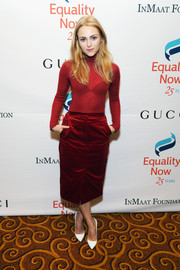 AnnaSophia Robb punctuated her red separates with a pair of white pumps.