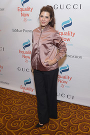 Marisa Tomei paired a shiny mauve bomber jacket with black trousers for the Make Equality Reality Gala.