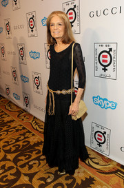 Gloria Steinem teamed a sheer black scoopneck mesh top with a gold decorative belt for the Make Equality Reality event.